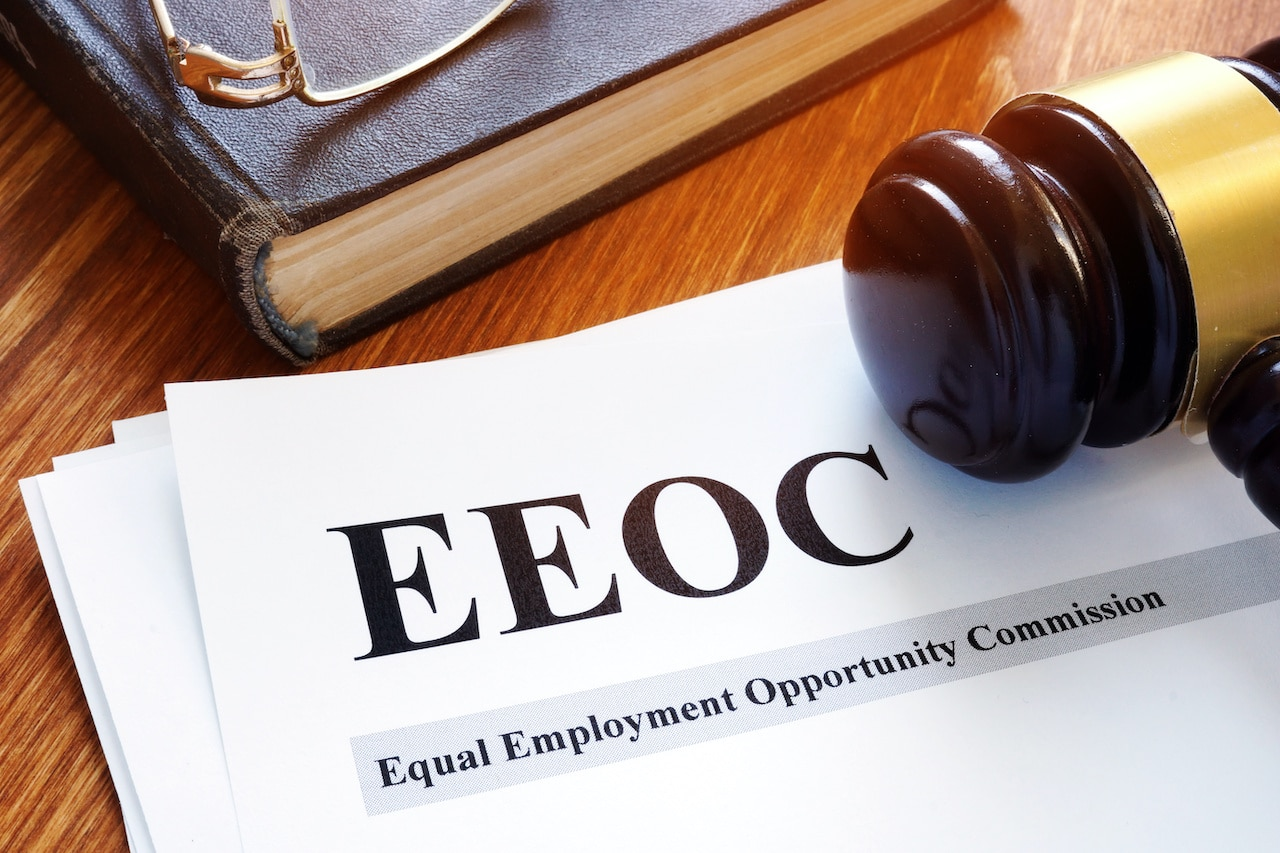 Gavel sitting on Equal Employment Opportunity commission paperwork