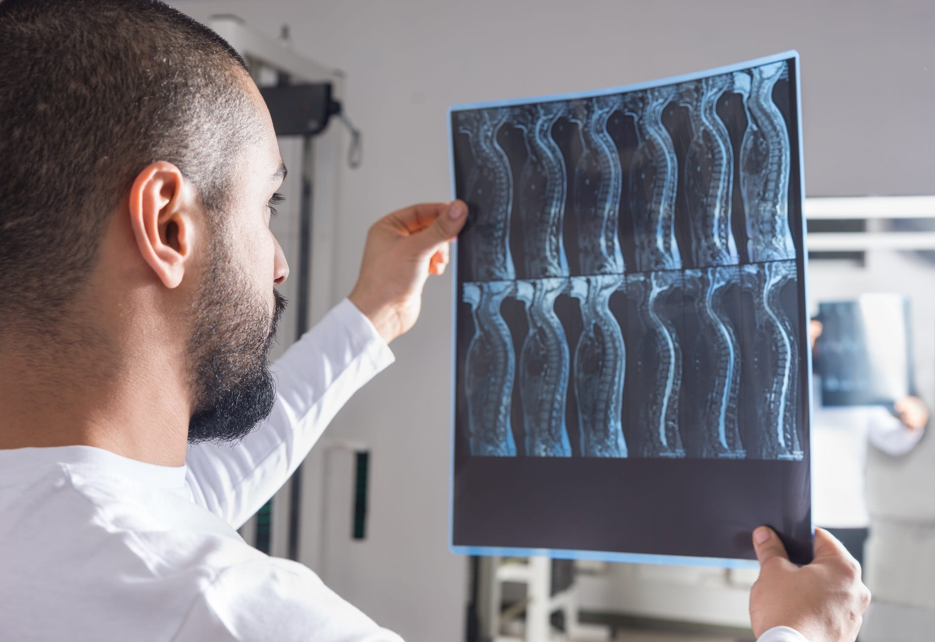 Doctor analyzing X-ray image in consulting room