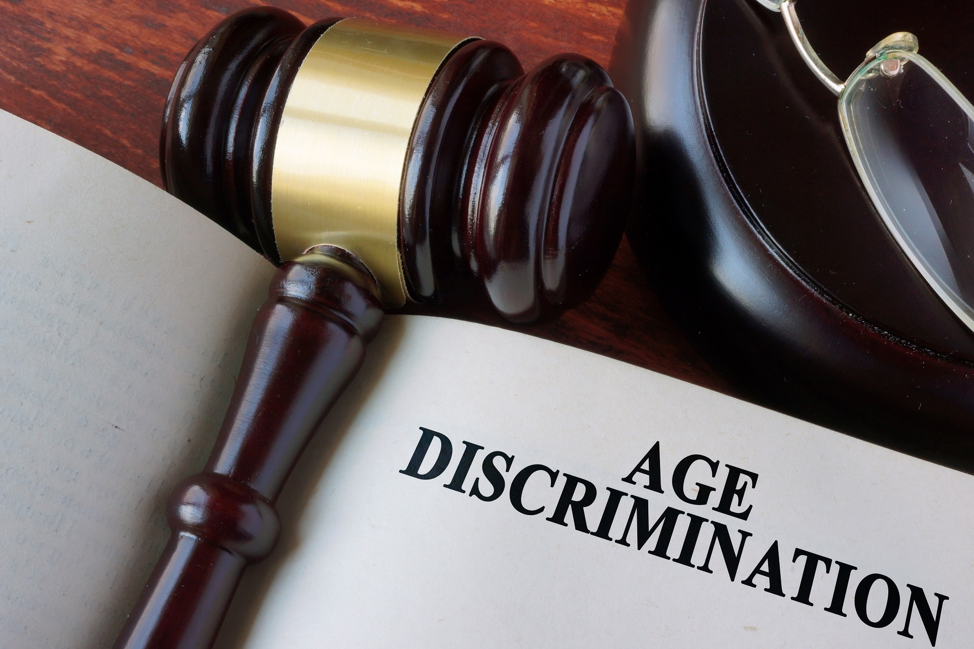 Gavel laying on open book page entitled Age Discrimination