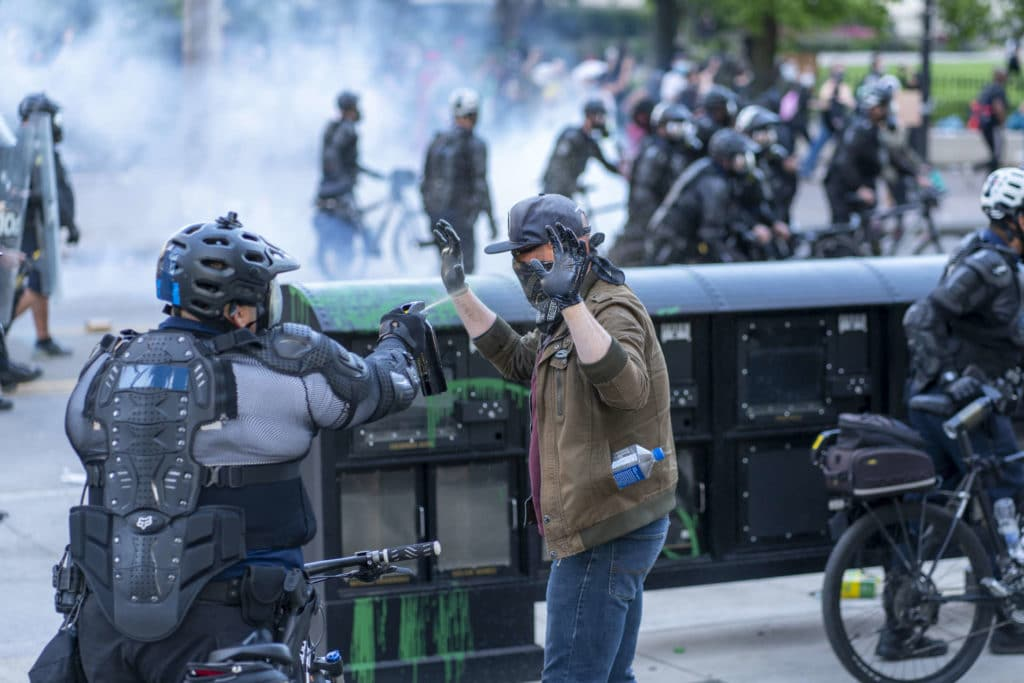 Highly protected Police Pepper Spraying Protestors
