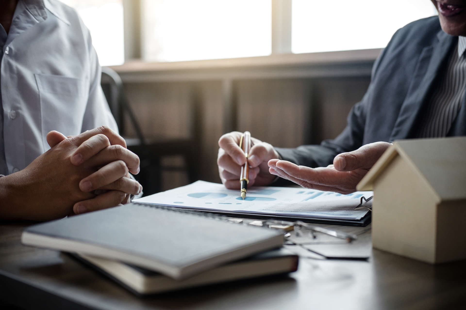 Businessman reviewing documents with another man