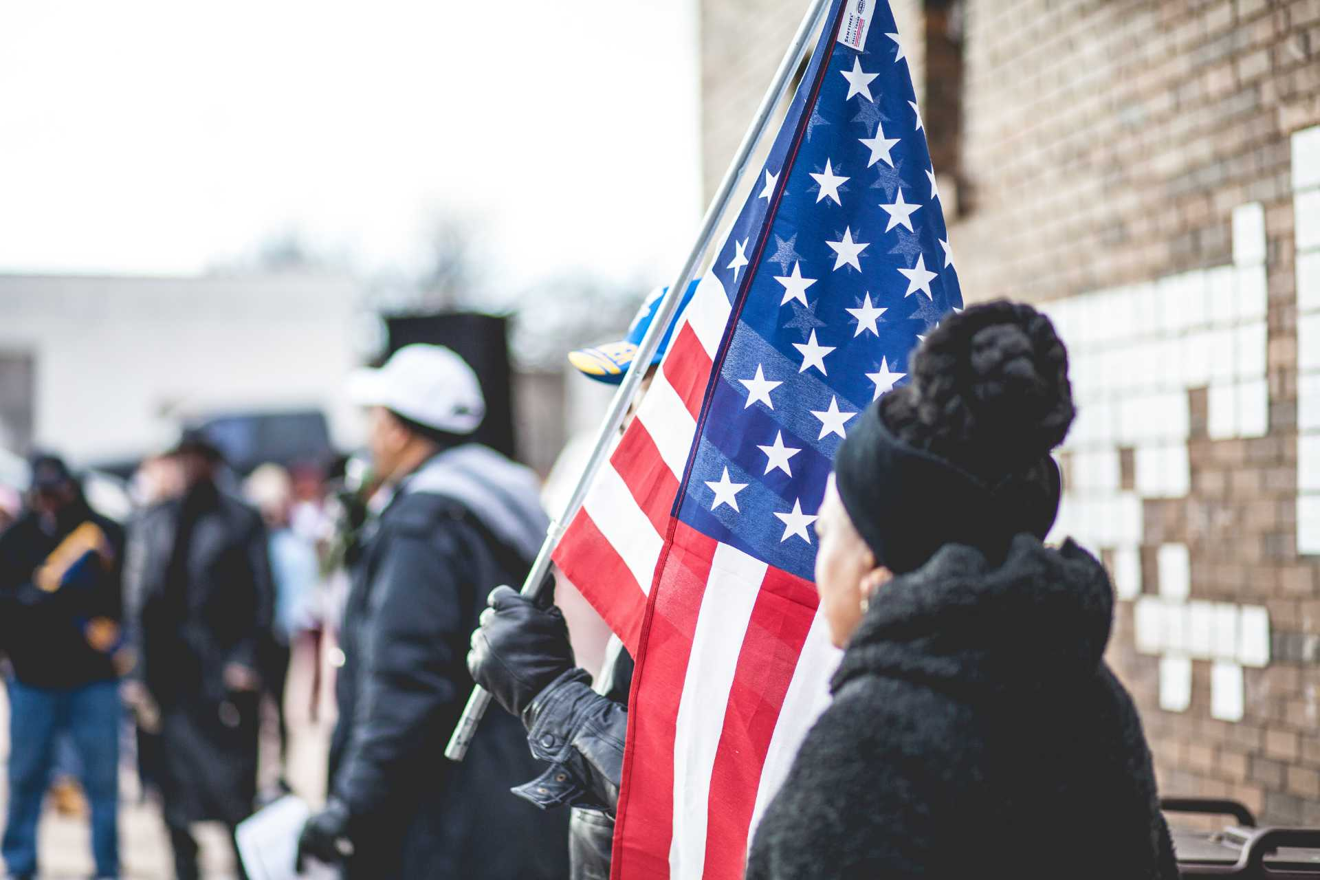 Protestors holding American Flag