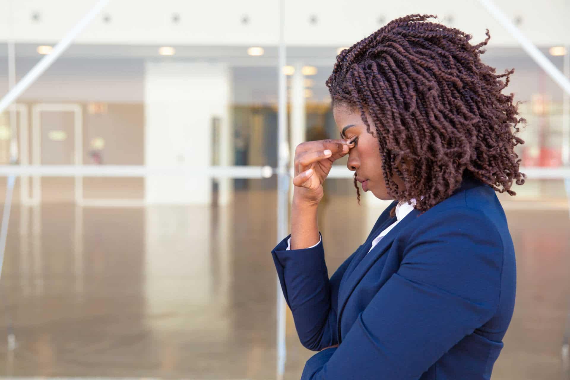 Serious upset female employee thinking over bad news